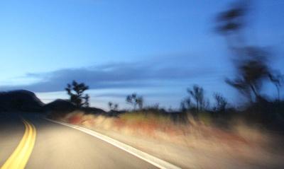 Road and sky-leaving Joshua Tree