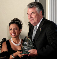 Brigitte presenting Congressman Peter King (R NY) with his National Security Patriot Award
